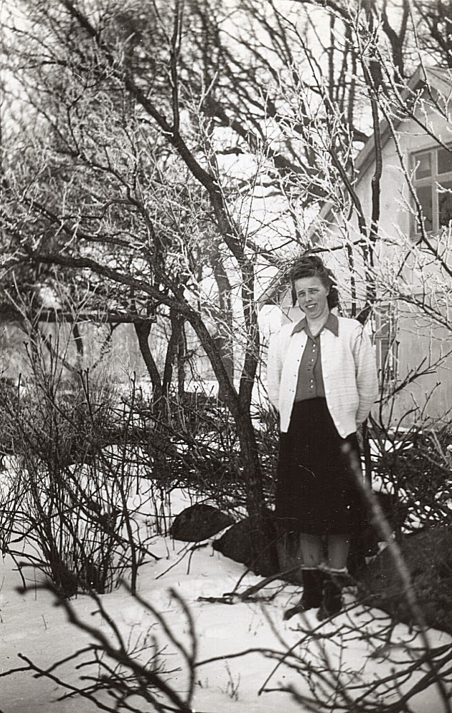 OM.2014.009 – Photograph of a woman in a thicket